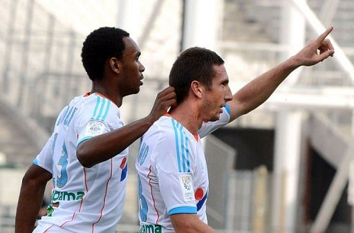 Marseille's Morgan Amalfitano (R) celebrates with Julio Nkoulou