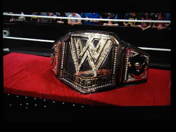 the rock unveils a new wwe championship belt