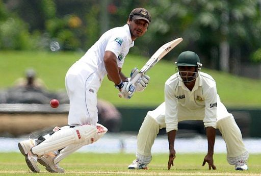 Kumar Sangakkara (left) plays a shot during a Test match against Bangladesh in Galle on March 8, 2013