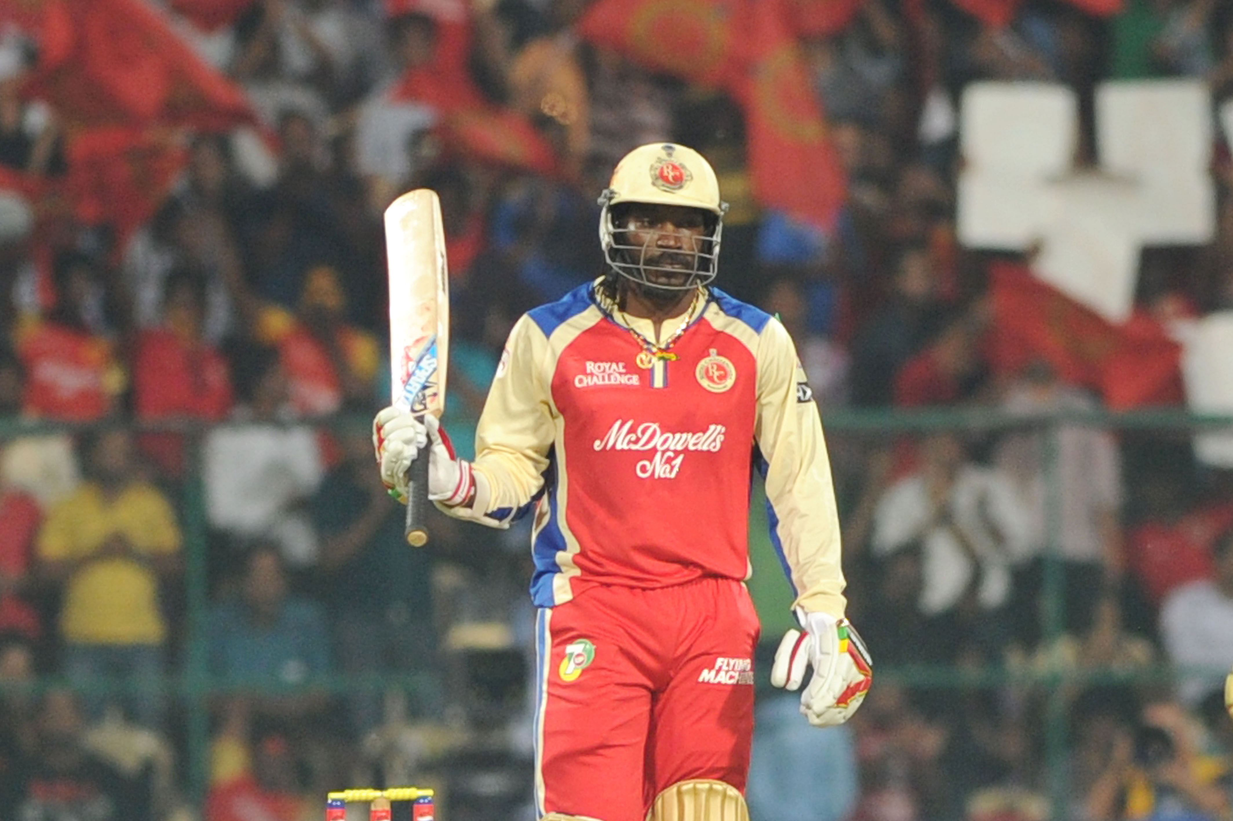 Chris Gayle in action during the match between RCB and MI in Bangalore on April 4 2013. (Photo: IANS)