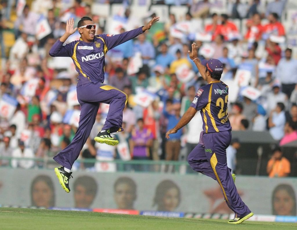 KKR bowler Sunil Narine exults after getting a hat-trick during the match between Kings XI Punjab and Kolkata Knight Riders match at Mohali on April 16, 2013. (Photo: IANS)