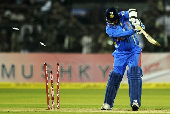 Indian cricketer Virender Sehwag miss a shot as he is clean bowled during the first One Day International(ODI) match between Indian and West Indies at the Barabati Stadium in Cuttack on November 29, 2011.