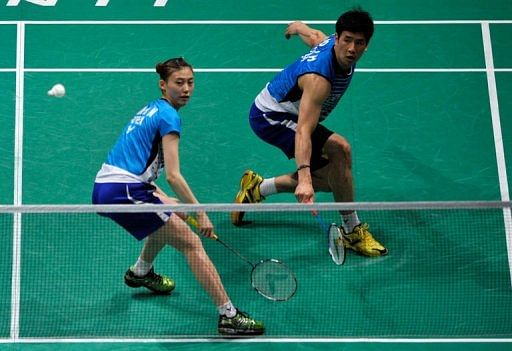 Ko Sung Hyun (right) of South Korea hits a return during the mixed doubles semi-final  in Kuala Lumpur on May 25, 2013