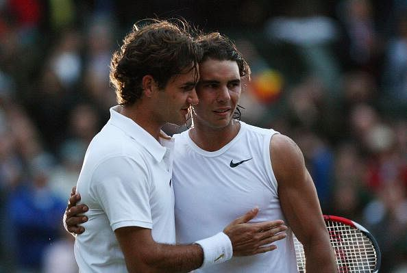 Roger Federer of Switzerland congratulates Rafael Nadal of Spain in winning match point and the Championship during the men's singles Final on day thirteen of the Wimbledon Lawn Tennis Championships at the All England Lawn Tennis and Croquet Club on July 6, 2008 in London, England.  (Photo by Ryan Pierse/Getty Images)