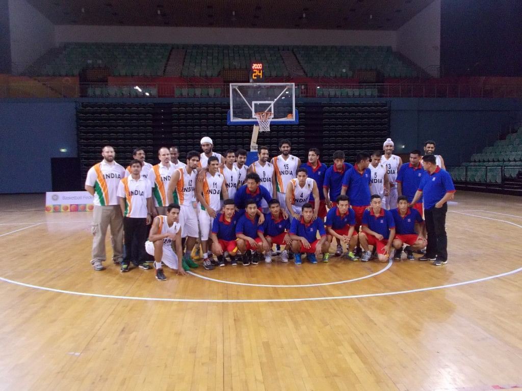 Friendly Neighbours: The India and Nepal teams pose for a joint photograph after the game. Copyright: Gopalakrishnan R