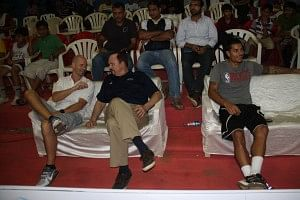 Coach Flemming (centre) with NBA India's Senior Director Troy Justice during the Ramu Memorial Tournament, Mumbai.