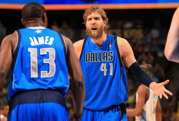 Dirk Nowitzki #41 of the Dallas Mavericks talks with Mike James #13 s as they face the Denver Nuggets at the Pepsi Center on April 4, 2013 in Denver, Colorado. The Mavs made a pact to not shave until they reached a .500 record and they reached 40-40-40 in April and that's when Nowitzki got rid of his beard. (Getty Images)