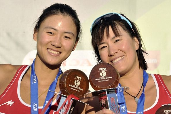 Gold medalists Chen Xue (L) and Xi Zhang (R) from China hold their trophies during the medal ceremony on day 6 of the FIVB Beach Voleyball World Championships on July 6, 2013 in Stare Jablonki, Poland.  (Getty Images)