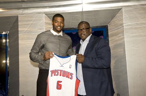 Joe Dumars, President of Basketball Operations (R) poses with new Detroit Piston, Josh Smith and his new jersey at a press conference on July 10, 2013 at Palace of Auburn Hills in Auburn Hills, Michigan. (Getty Images)