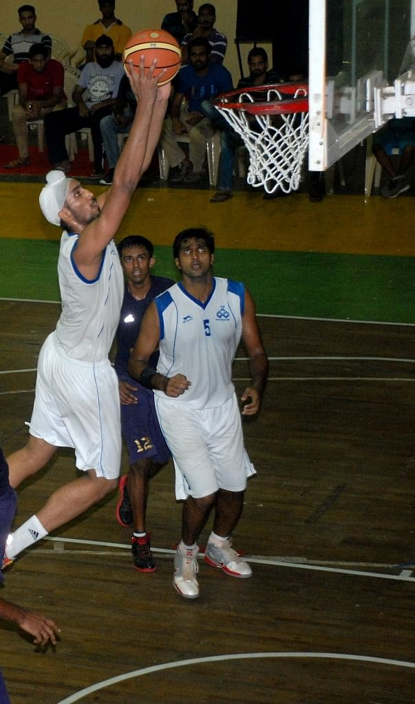 The Indian Overseas Bank Power Forward Amjyoth Singh is about dunk the ball in their match against Central Excise, Kochi. Photo Courtesy: Tournament Organisers.