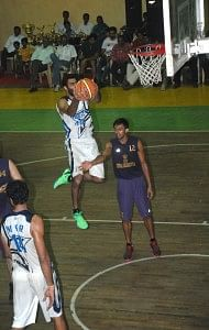 Forward Yadwinder Singh grabs a defensive rebound for ONGC.