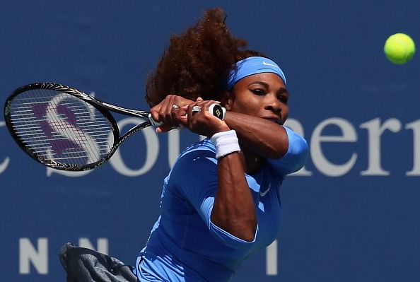 Erratic Serena Williams moves into third round at Cincinnati
