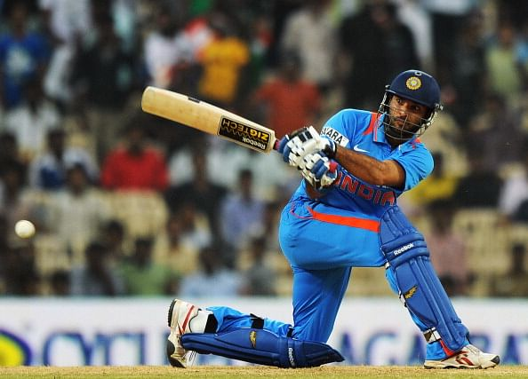 Indian cricketer Yuvraj Singh plays a sh