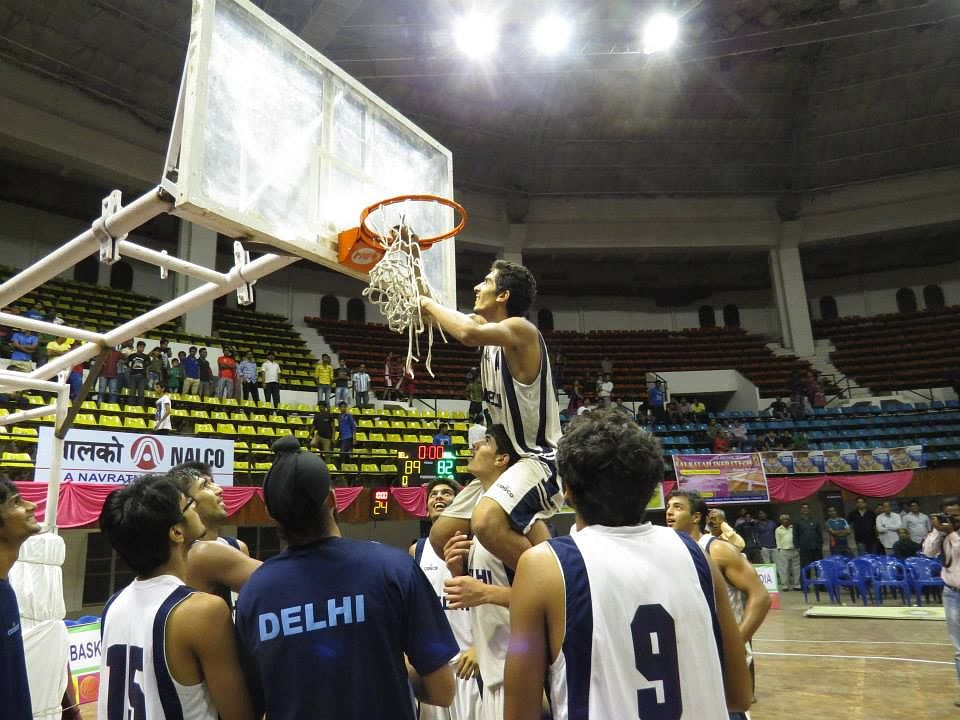 Delhi boys cut out the nets as keepsakes. Photo Courtesy: BFI