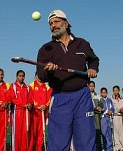Baldev Singh, Deputy Director and Hockey Coach in Hary Sports Department with Women's Hockey Team at Shahbad Hockey Centre in Haryana, India