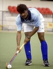 Dhanraj Pillay, Player and Captain of Indian Hockey Team playing at a playground ( Sports, Profile )