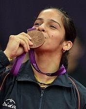 India's Saina Nehwal kisses her bronze m