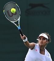 India's Sania Mirza serves during warm-u