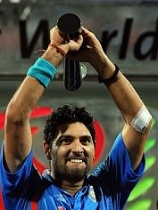 Indian cricketer Yuvraj Singh reacts aft