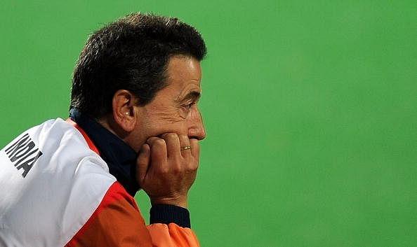 Indian hockey coach Jose Brasa looks on