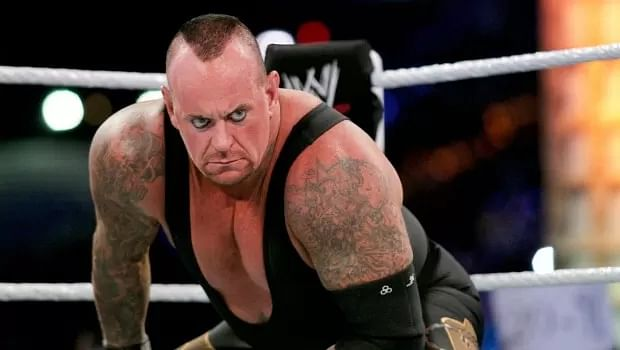 Undertaker attends boxing Undertaker And Michelle Mccool 2013