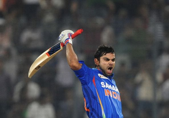 Indian batsman Virat Kholi reacts after