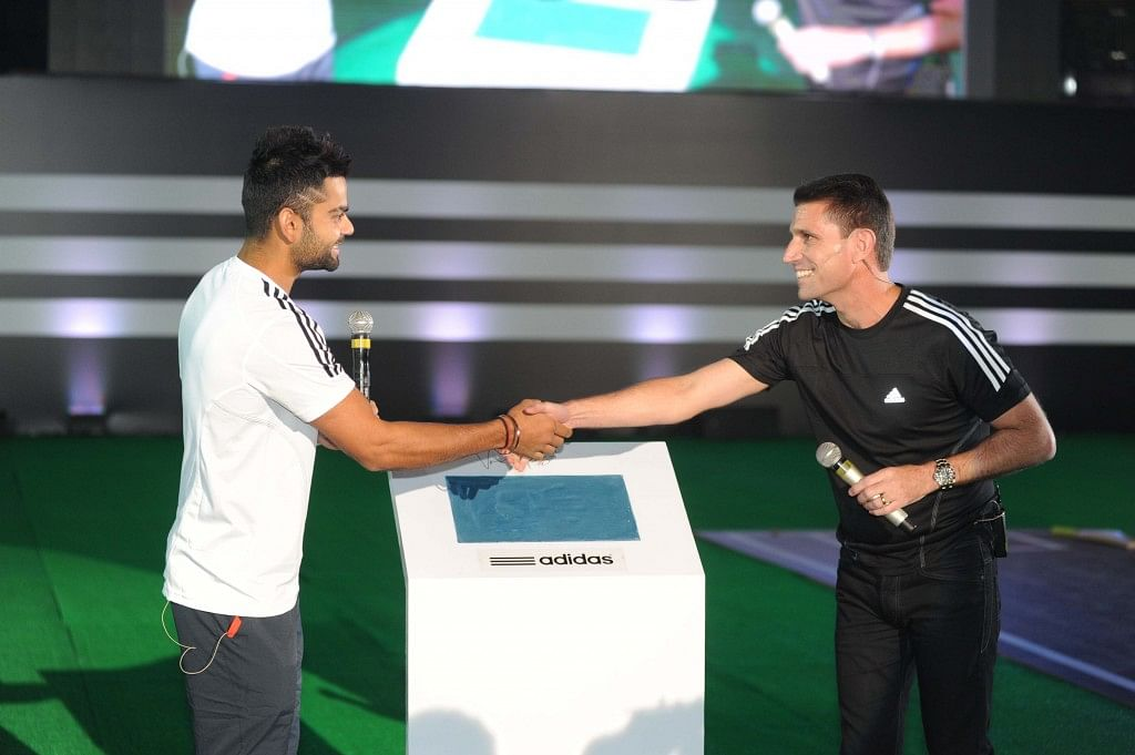 Virat Kohli takes the pledge with Erick Haskell, MD Adidas