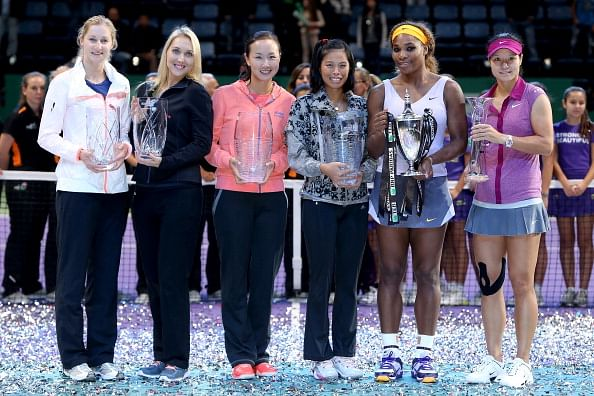 Weekend round-up: Li Na, Guan, Rory all fall, Tiger's in town, and Evergrande sitting pretty