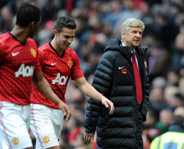 Arsene Wenger finds it 'strange' to see Robin van Persie in a Manchester United shirt