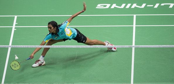 Srikanth storms into semis, Sindhu out