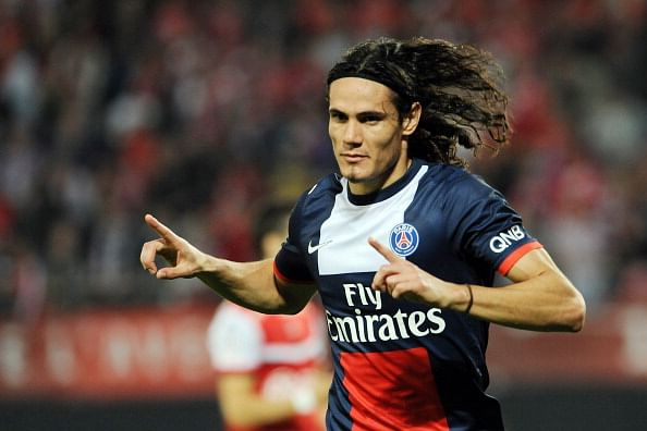 Paris Saint-Germain's Uruguayan forward Edinson Cavani celebrates after scoring a goal during a French L1 football match between Valenciennes and Paris Saint-Germain on September 25, 2013 at the Stade du Hainaut in Valenciennes, northern France. AFP PHOTO / FRANCOIS LO PRESTI        (Photo credit should read FRANCOIS LO PRESTI/AFP/Getty Images)