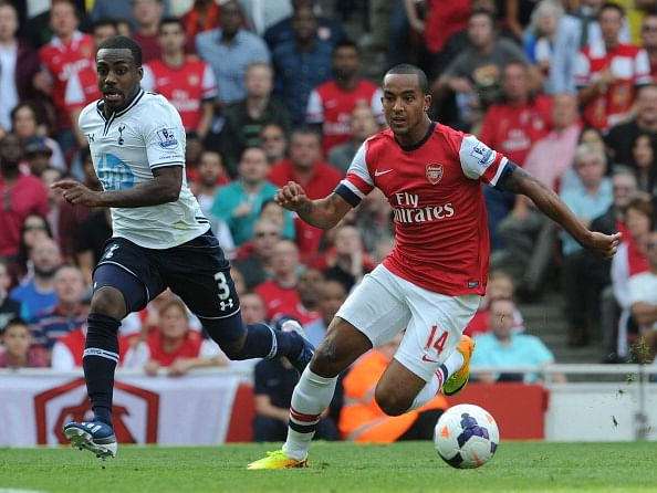 LONDON, ENGLAND - SEPTEMBER 01:  Theo Walcott of Arsenal races away from Danny Rose of Tottenham during the Barclays Premier League match between Arsenal and Tottenham Hotspur at Emirates Stadium on September 01, 2013 in London, England.  (Photo by David Price/Arsenal FC via Getty Images)