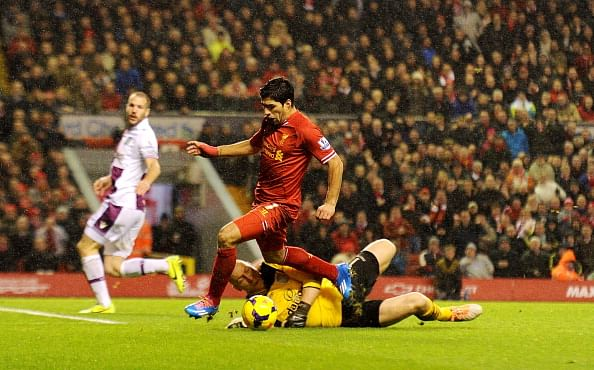 Luis Suarez of Liverpool is fouled by Brad Guzan of Aston Villa for a penalty