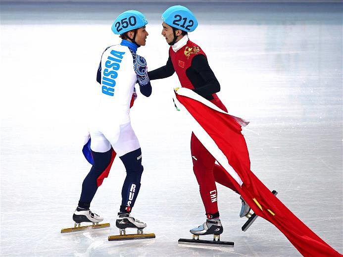 Two silvers and a bronze for China on a night of drama at the 2014 Sochi Winter Olympics