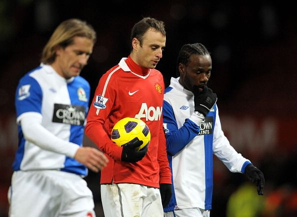 Dimitar Berbatov takes the match ball after scoring 5 against Blackburn