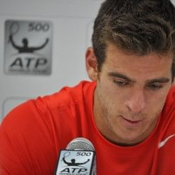 Juan Martin del Potro disconsolate in Dubai after being forced to retire with an injured wrist