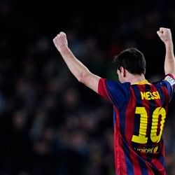 Barcelona go top of La Liga as Lionel Messi equals Raul's record