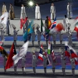 Indian athletes march under national flag at Sochi Winter Olympics closing ceremony