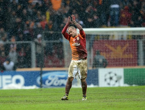 Wesley Sneijder of Galatasaray celebrates after scoring a goal during the UEFA Champions League group B soccer match between Galatasaray and Juventus at Turk Telekom Arena on December 11, 2013 in Istanbul, Turkey.