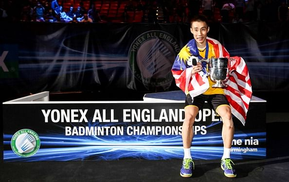 Lee Chong Wei, Wang Shixian win All England titles