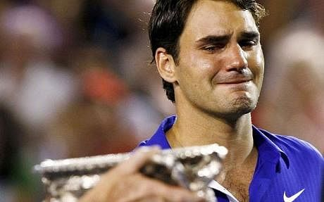 Emotional: Roger Federer cries as he watches Nadal being handed the trophy