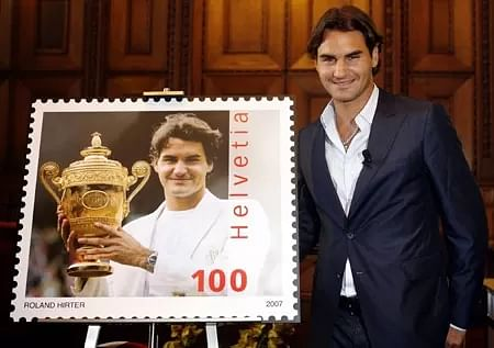 In 2007, Roger Federer became the first living Swiss person to be featured on a Swiss stamp. The postage picture features Roger holding the Wimbledon trophy.