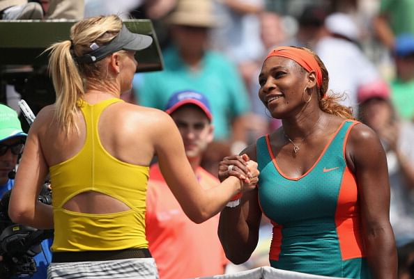 Serena Williams of the United States shakes hands at the net after her straight sets victory against Maria Sharapova of Russia during their semi final round match during day 11 at the Sony Open at Crandon Park Tennis Cente on March 27, 2014 in Key Biscayne, Florida.