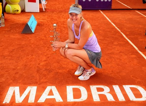 Maria Sharapova battles past Simona Halep to clinch Madrid title