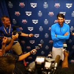 Michael Phelps wins the men's 100m butterfly final at the 2014 Charlotte Grand Prix