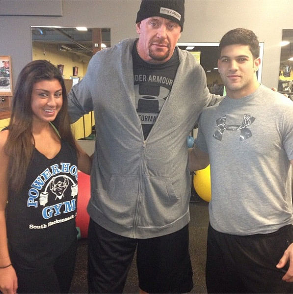 The Undertaker with two young Undertakers Children