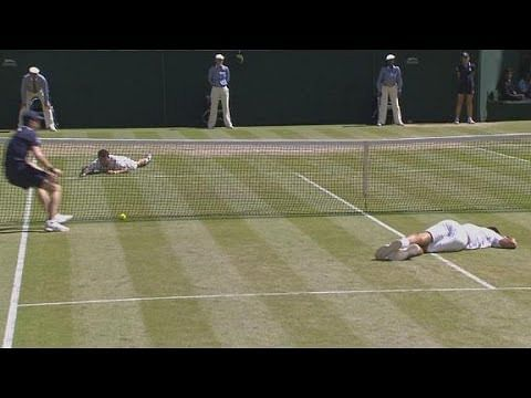 It's a slippery slope: Djokovic and Dimitrov both slip and fall at the same time during their Wimbledon semifinal