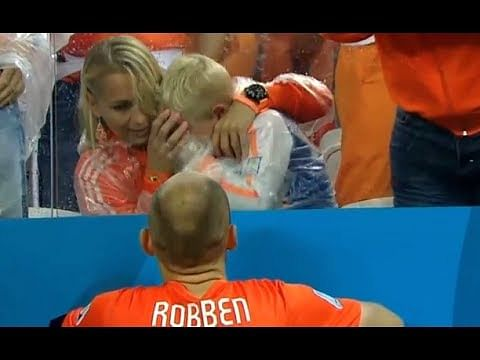 Netherlands' Arjen Robben consoles his son who is in tears after defeat against Argentina
