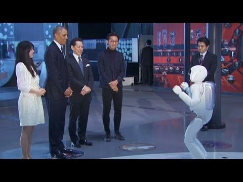 US President Barack Obama plays football with Japanese robot ASIMO