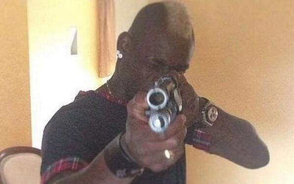 Mario Balotelli posts a photograph of himself posing with a gun on Instagram